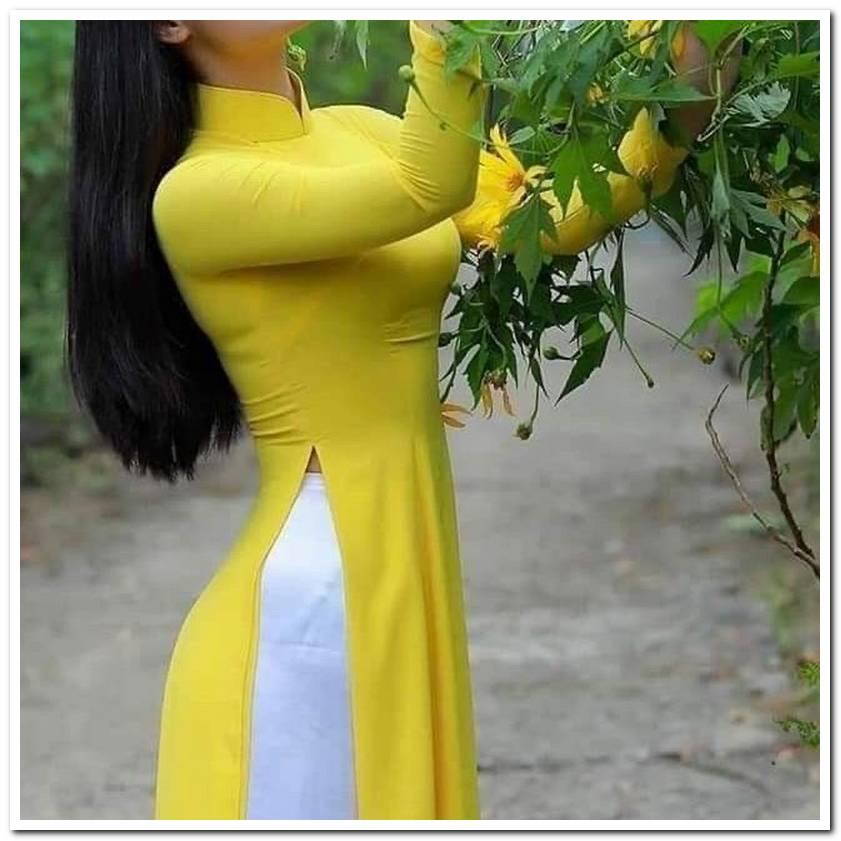 Áo dài lễ tân màu vàng